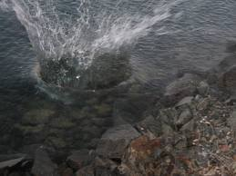 decorative image of a rock hitting the water